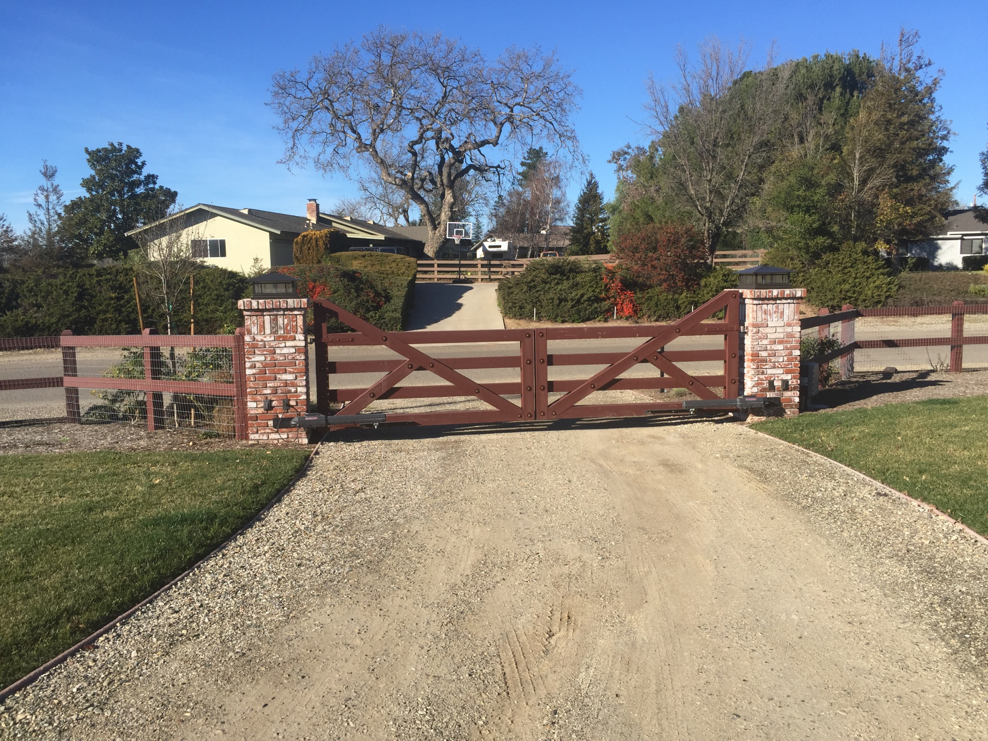 Custom wood gates with Liftmaster LA500 swing gate actuators